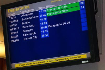 Image of a departure gate screen at an airport
